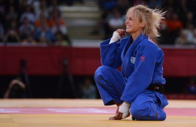 Italy's Rosalba Forciniti (blue) celebrates after winning against Luxemburg's Marie Muller during their women's -52kg contest match of the judo event at the London 2012 Olympic Games on July 29, 2012 ExCel arena in London.    AFP PHOTO / FRANCK FIFE        (Photo credit should read FRANCK FIFE/AFP/GettyImages)